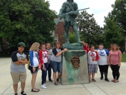 Boyle County students pose in front of the Daniel Boone statue on the EKU Richmond Campus.