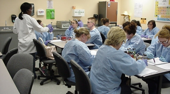Students in lab coats sitting in class